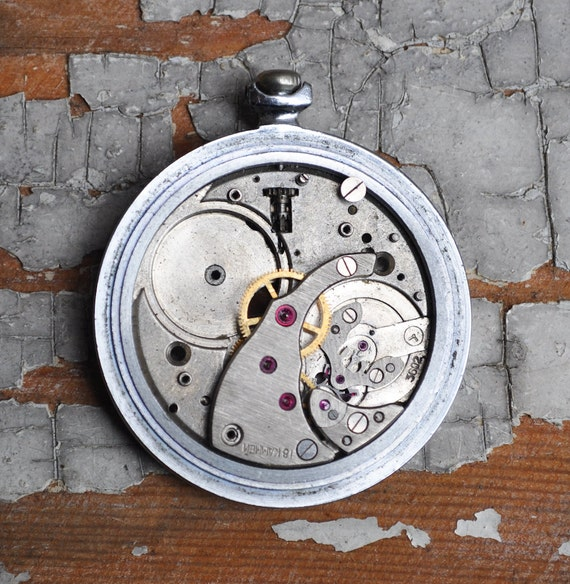 Vintage pocket watch case with movement.
