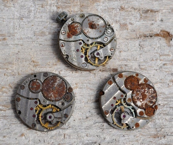 Lot of 3 vintage rusty watch movements.