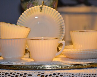 Four Vintage Fire King Opalescent Cups and Saucers