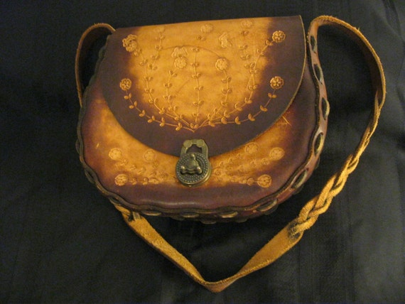 Western style leather purse with tooled flower design