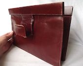 1960s French clutch bag in red brown color