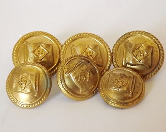 Six brass buttons in two sizes from a shipping line