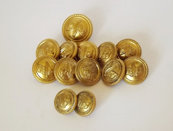 Thirteen New Zealand Shipping Co. brass buttons in three different sizes