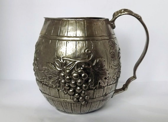 Heavy pewter pitcher or jug with grape decoration from Europe
