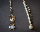 One of a kind pearl strand and clock charm earrings featuring watch parts