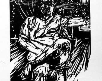 Relief linocut of a man in a boat