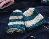 blue and white knit baby hat