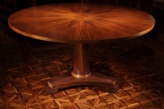 Dining table, done in santos rosewood with a column base