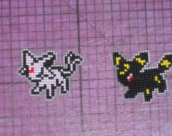 Espeon and Umbreon Set (cross stitched pin or magnets)