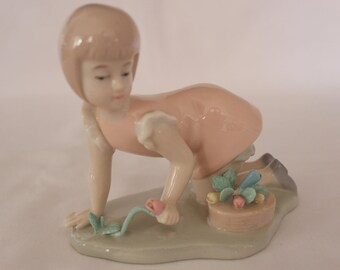 Vintage Figurine Girl Picking Floweres