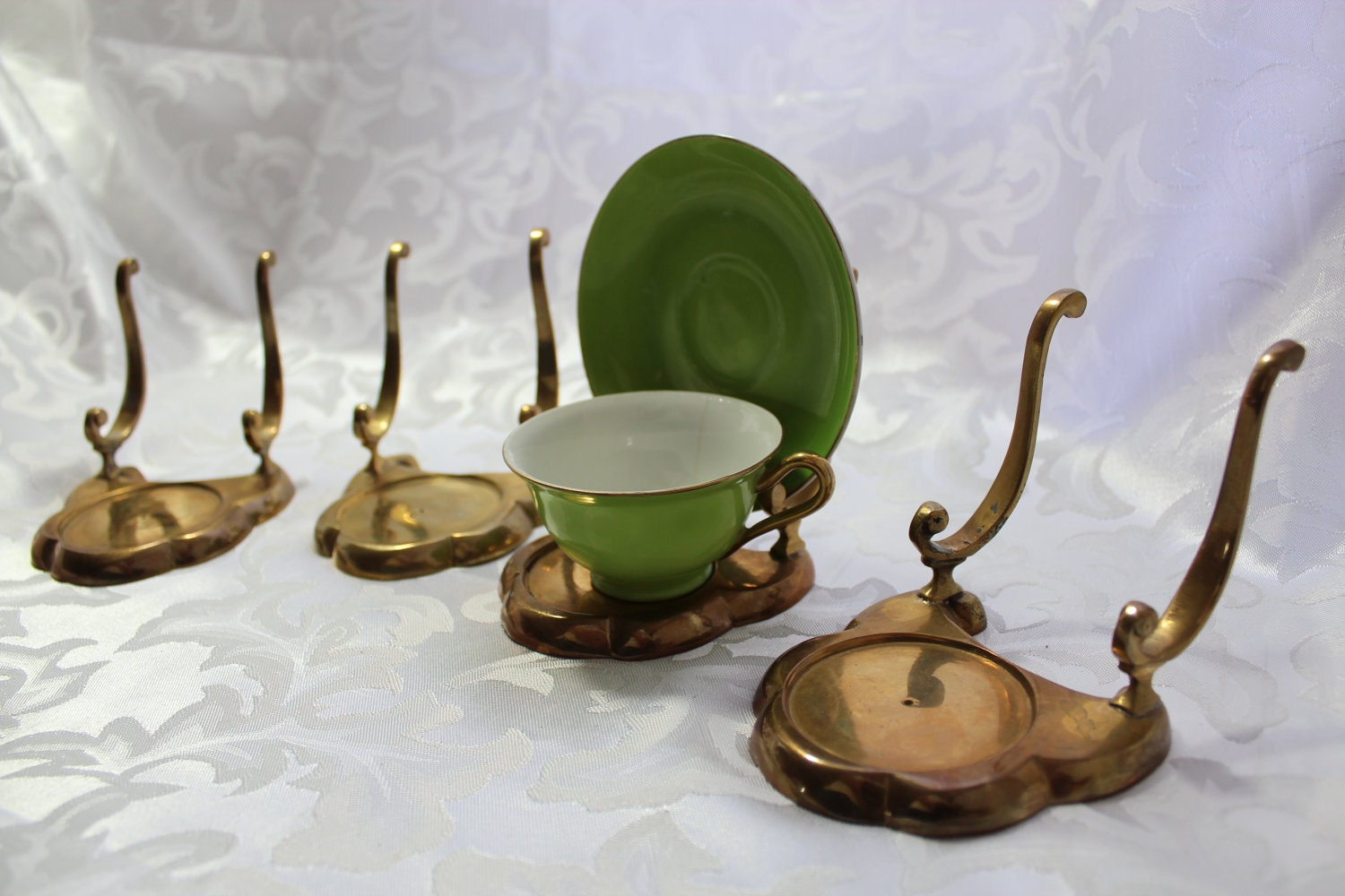 Teacup and Saucer Holders, Cup and Saucer Hangers Fine Home Displays has a huge variety of cup and saucer hangers and stands available so that you can get your treasured collectibles on display! We're really sorry.