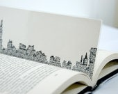 Typewritten Chicago city skyline bookmark, A laminated page marker, Chicago city silhouette made out of typeface.