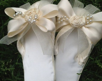Custom made ivory satin flip flops.  Great for weddings, bride's maids gifts, or fun summer wear.