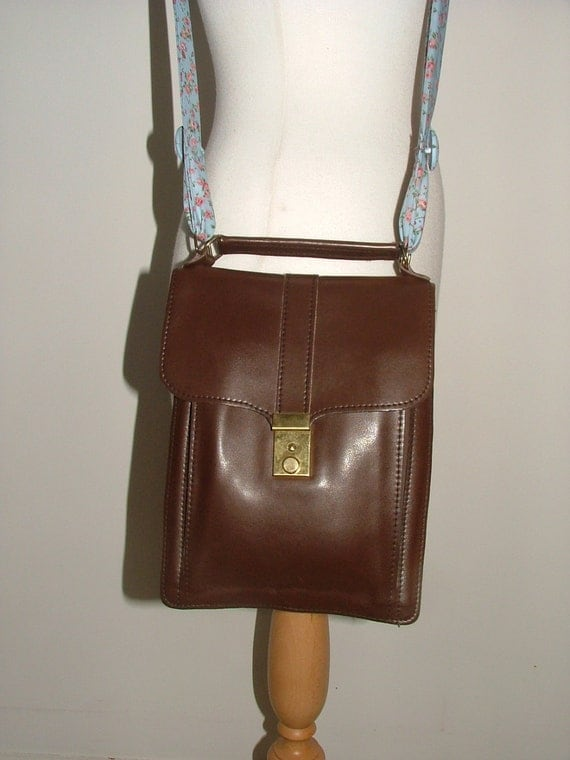 Reworked vintage brown leather  satchel saddle bag with floral fabric bow strap