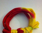 Upcycled Red and a touch of green and yellow  T-Shirt Bracelet.  OOAK