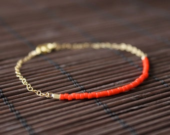 neon red - lucky gold delica bracelet