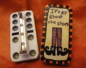 "The ""It's all about the shoes"" Dominoe Pin featuring witch's shoes and stockings"