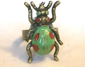 beetle ring in green, red and antique brass