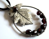 Silver leaf necklace pagan poetry with garnets in burgundy red oak leaf magical pendant pear shape