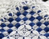 Blue and white checked vintage table linen with white crochet edge