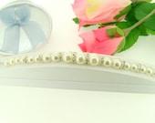 ivory pearl bridal bracelet designed with swarovski rondells