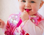 Baby-to-Toddler Bib, Waterproof & Wipeable Laminated Cotton, Snap Pocket, Reversible (Passion Lily / Lindy Leaf)