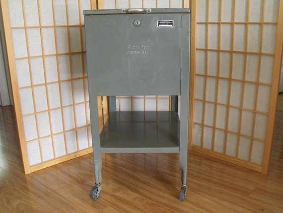 vintage metal storage cabinet on wheels. Black Bedroom Furniture Sets. Home Design Ideas