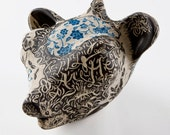forest animal head sculpture