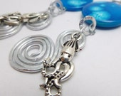 Squid Charm Earrings, blue, swirl earrings, mother of pearl, silver charms, hammered silver
