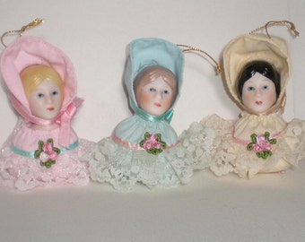 Porcelain Doll Head Ornaments by Charisma