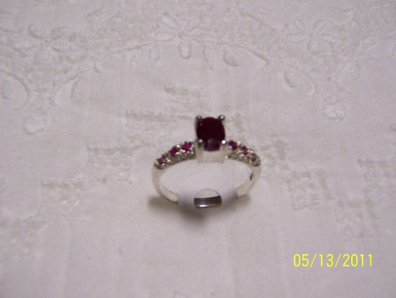 RESERVED For Wanda.  REDUCED. Vintage Ruby Solitary and rubies accents ring sz.9. sterling silver.