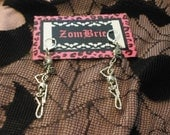 Skeletons hanging on noose dangle earrings