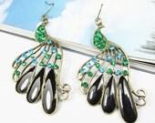 Beautiful Filigree stone Peacock Earrings with black enamel and green gem