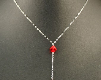 The Nancy necklace is made from sterling silver chain and Red Swarovski crystals.