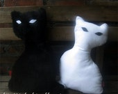 Midnight and Sundance: a pair of cat pillows