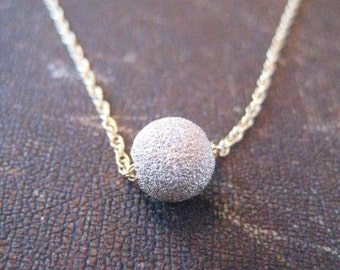 14K gold filled necklace with star dust ball