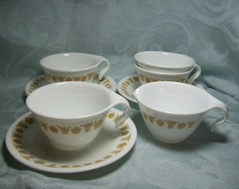 "Corelle ""Butterfly Gold"" Cups, Saucers, and Creamer"