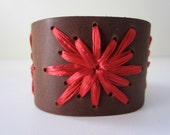 Cornelia cuff. Brown leather cuff woven with ruby red vintage Swistraw by Ruby Buffalo.