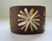Margaret cuff. Brown leather cuff woven in ivory, chocolate brown and celery green vintage Swistraw by Ruby Buffalo.