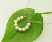 Horseshoe Necklace, Swarovski Ivory Pearls gold necklace. Horseshoe charm, Bridal jewelry, Necklace with horseshoe - Fifi LaBonge -