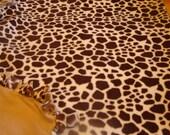 Fleece blanket, giraffe print  fleece, the other side is camel in color .