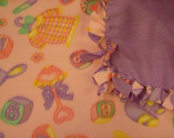 Fleece blanket  Pretty pink with baby toys on it , other side is all lavender.