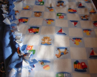 Fleece blanket Light blue with rocking horses,ducks,boats, and ducks, other side is all medium blue