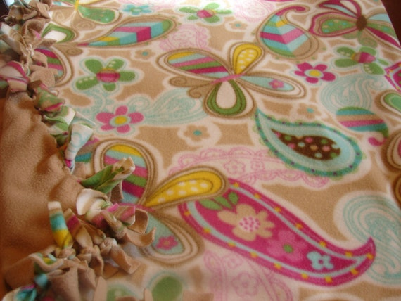 Fleece blanket camel colored fleece with multi color flowers and butterflies,  other side is all camel color,