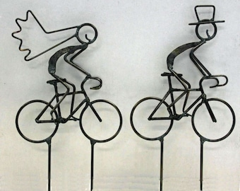 Bride and Groom on Road Bikes Cake Toppers