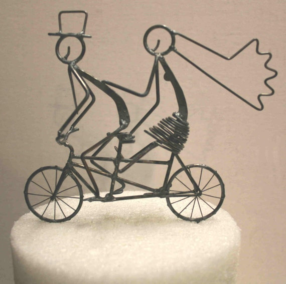 Bride With Feet Off Pedals Tandem Cake Topper With Rear Basket With a Dog, and Lightning Bolts in the Wheels Parallel to the Ground