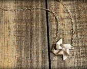 Pinwheel Necklace in Matte Silver