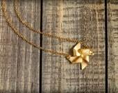 Pinwheel Necklace in Matte Gold