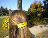 Fun, stylish Barrettes made with Upcycled Monopoly money