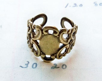 FOUR Sturdy adjustable ring base, brass ox